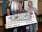 Robbie Berrill representing Carrick and Slane Walkers and Brian Kelly from The Boyne Valley Inn present a cheque to Marie Thompson from The Gary Kelly Cancer Support Centre for €3000. Photo:Colin Bell/pressphotos.ie