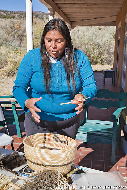 Los Luceros is a grand historical hacienda and home site on the Rio Grande River in the Espanola Valley near the village of Alcalde, New Mexico..Archeologist Assistant Mary Weahkee shows a waterproof basket she made from bullrushes.
