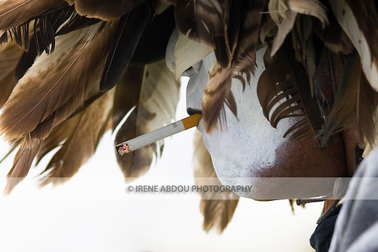 A Native American at the Healing Horse Spirit PowWow in Mt. Airy, Maryland smokes a cigarette during a dance break.