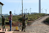 KENYA, Nairobi, Ngong Hills, 25,5 MW Wind Power Station with Vestas and Gamesa wind turbines, owned and operated by KENGEN Kenya Electricity Generating Company, guard at entry gate / KENIA, Ngong Hills Windpark, Betreiber KenGen Kenya Electricity Generating Company mit Vestas und Gamesa Windkraftanlagen