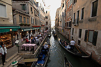 Gondalas and canal restaurant,Venice, Italy.