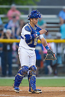Burlington Royals catcher Chase Vallot (8) gives defensive signs during the game against the Princeton Rays at Burlington Athletic Park on July 11, 2014 in Burlington, North Carolina.  The Rays defeated the Royals 5-3.  (Brian Westerholt/Four Seam Images)