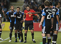 Referee Elias Bazakos instructs the San Jose Earthquakes players. The San Jose Earthquakes tied the Philadelphia Union 0-0 at Buck Shaw Stadium in Santa Clara, California on July 9th, 2011.