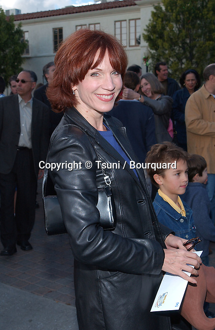 Marilu Henner  arriving at the Jimmy Neutron: Boy Genius premiere on the Paramount lot in Los Angeles. December 9, 2001.           -            HennerMarilu02A.jpg