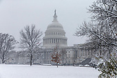 The United States Capitol Building is seen on a snowy afternoon in Washington, D.C. on March 21, 2018. Credit: Alex Edelman / CNP