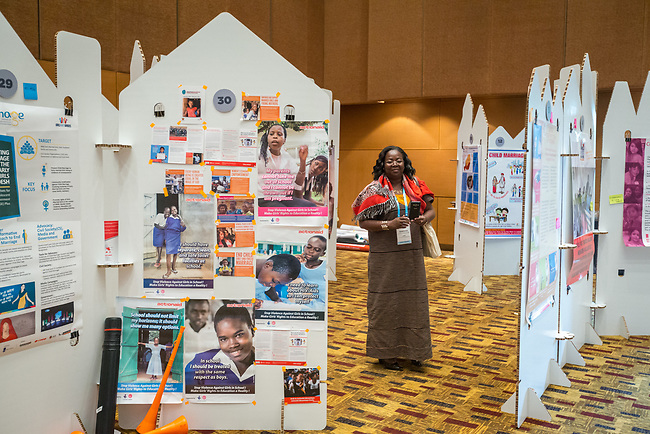 26 June, 2018, Kuala Lumpur, Malaysia : Hortense Lougue Kabore at the poster wall in The Village on the second day at the Girls Not Brides Global Meeting 2018 at the Kuala Lumpur Convention Centre. Picture by Graham Crouch/Girls Not Brides