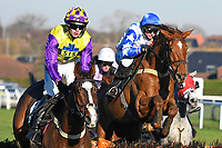 Winner of The Strong Flavours Catering Maiden Hurdle Oscarman (purple) ridden by Micheal Nolan and trained by Suzy Smith  during Horse Racing at Plumpton Racecourse on 2nd December 2019