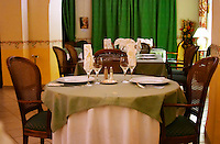 Minervois. At the hotel Chateau de Siran in Siran village. Languedoc. France. Europe. In the restaurant in the chateau dining room.