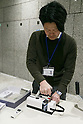 A member of staff collects old mobile phones from donors at Tokyo Metropolitan Government Building on February 21, 2017, Tokyo, Japan. Tokyo Government has asked for people to donate their old electronic gadgets (including smart phones, mobile phones and tablets) with the aim of collecting and recycling eight tonnes of gold, silver and bronze to make the 5,000 medals needed for the 2020 Tokyo Olympic and Paralympic Games. The recycling campaign started on Thursday, February 16. (Photo by Rodrigo Reyes Marin/AFLO)