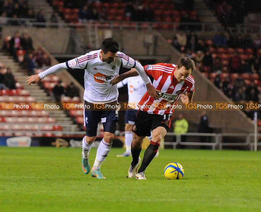 Bolton Wanderers's Chris Eagles tackles Sunderland's David Vaughan  - Sunderland vs Bolton Wanderers - FA Challenge Cup 3rd Round Replay Football at the Stadium of Light - 15/01/13 - MANDATORY CREDIT: Steven White/TGSPHOTO - Self billing applies where appropriate - 0845 094 6026 - contact@tgsphoto.co.uk - NO UNPAID USE