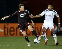 Mark Burch (4) of D.C. United moves the ball away from Sean Franklin (5) of the Los Angeles Galaxy during an MLS match at RFK Stadium, on April 9 2011, in Washington D.C.The game ended in a 1-1 tie.