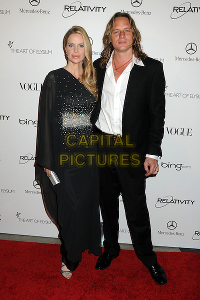 "KRISTIN BAUER & ABRI VAN STRATEN .attends the Art of Elysium 4th Annual Charity Gala ""Heaven"" held at The Annenberg Building at The California Science Center in Los Angeles, California, USA, January 15th 2011..full length long maxi black one sleeve dress couple married husband wife white shirt silver clutch bag .CAP/ADM/BP.©Byron Purvis/AdMedia/Capital Pictures."