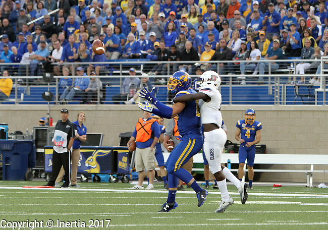 BROOKINGS, SD - AUGUST 31: Dallas Goedert #86 from South Dakota State University hauls in a pass while being draped by Alex Smith #12 from Duquesne in the first half of their game Thursday night at Dana J. Dykhouse Stadium in Brookings. (Photo by Dave Eggen/Inertia)