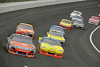 Marcos Ambrose (#9), Ryan Newman (#39), Kyle Busch, (#18) M&M's Camry and Joey Logano, (#20).