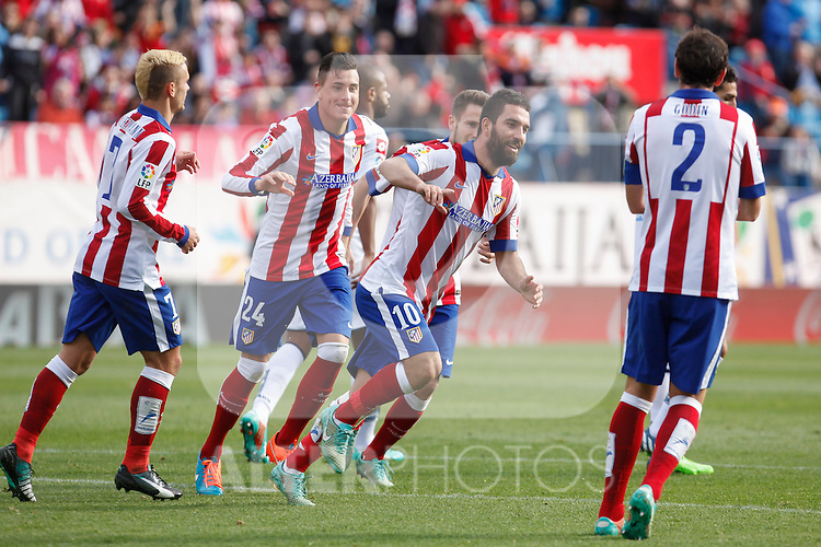 Atletico de Madrid´s Arda Turan celebrates a goal with Gimenez and Griezmann during 2014-15 La Liga match between Atletico de Madrid and Deportivo de la Coruña at Vicente Calderon stadium in Madrid, Spain. November 30, 2014. (ALTERPHOTOS/Victor Blanco)