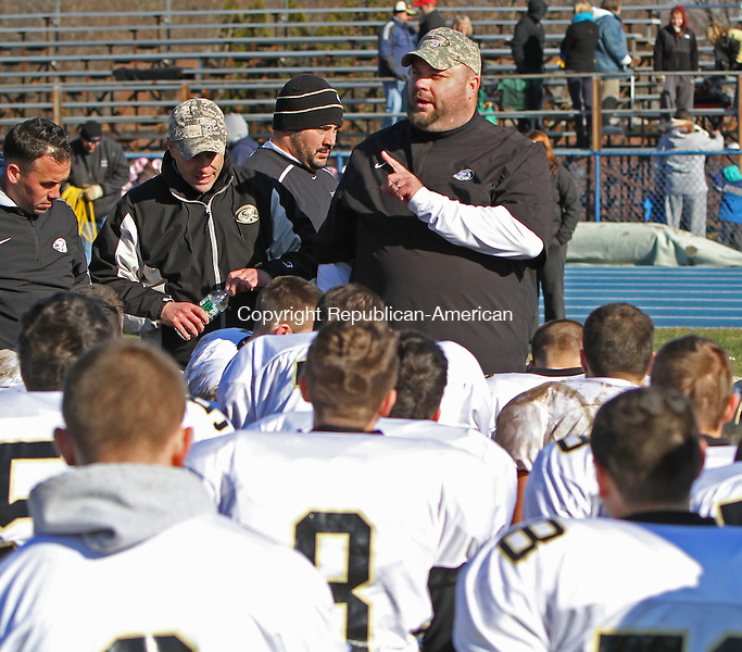 SEYMOUR, CT-29 November 112913MK01 Woodland's coach Tim Shea addresses his team after a come from behind victory over the Seymour Wildcats at Seymour High School on Friday morning.  The Woodland Hawks defeated Seymour 22-19.  Michael Kabelka / Republican-American