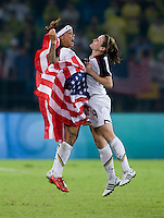 USWNT forward (6) Natasha Kai chest bumps teammate (9) Heather O'Reilly in celebration after playing for the gold medal at Workers' Stadium.  The USWNT defeated Brazil, 1-0, during the 2008 Beijing Olympic final in Beijing, China.