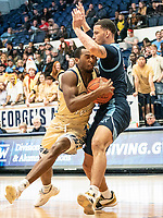 WASHINGTON, DC - FEBRUARY 8: Maceo Jack #14 of George Washington pushes into Tyrese Martin #4 of Rhode Island during a game between Rhode Island and George Washington at Charles E Smith Center on February 8, 2020 in Washington, DC.