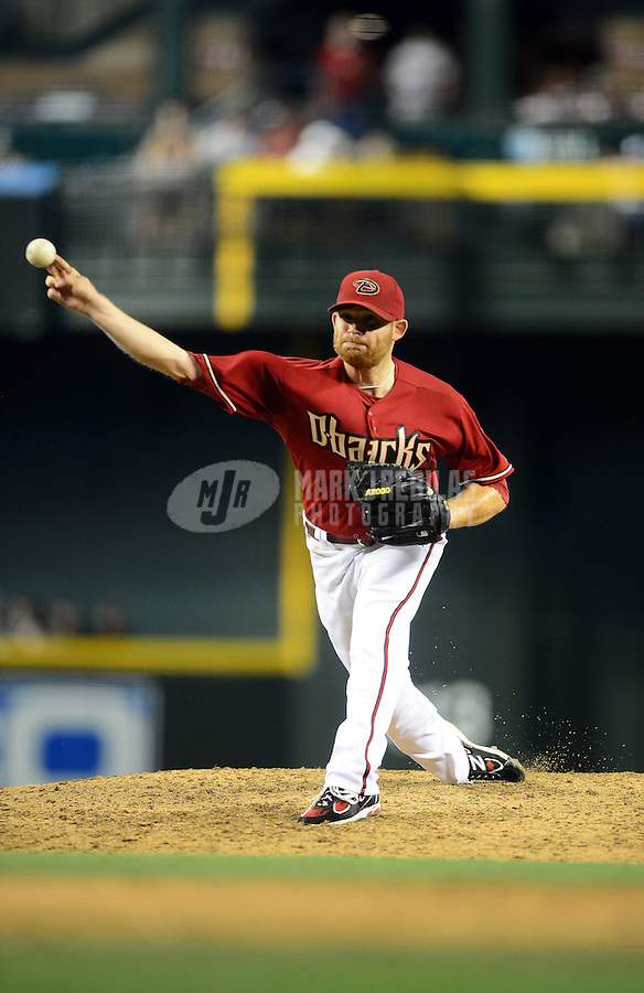 Apr. 22, 2012; Phoenix, AZ, USA; Arizona Diamondbacks pitcher Ian Kennedy throws in the sixth inning against the Atlanta Braves at Chase Field. Mandatory Credit: Mark J. Rebilas-