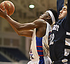 Dami Awosika #32 of South Side, left, looks to drive to the net as Matthew Mannino #12 of Hewlett defends during the Nassau County varsity boys basketball Class A semifinals at Hofstra University in Hempstead, NY on Wednesday, March 1, 2017. Awosika scored 11 of his 16 points in the second quarter of South Side's 58-46 win.