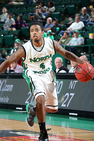 DENTON, TX - DECEMBER 16: P.J. Hardwick #4 of the North Texas Mean Greenin action against the Southeastern Louisiana Lions at the UNT Coliseum on December 16, 2012 in Denton, Texas. (Photo by Rick Yeatts/Getty Images)