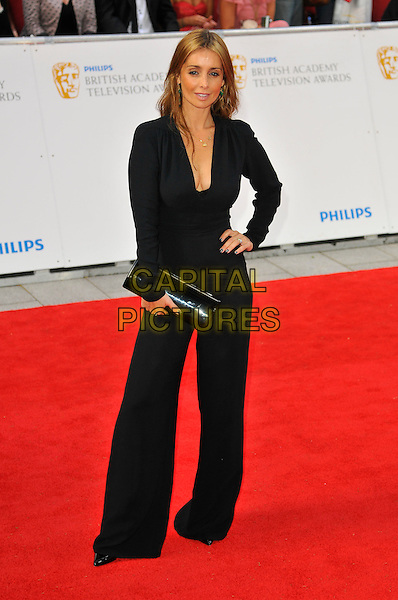 LOUISE REDKNAPP .Attending the Philips British Academy Television Awards, Grosvenor house Hotel, Park Lane, London, England, UK, May 22nd 2011..arrivals TV Baftas Bafta full length black catsuit jumpsuit hand on hip cleavage long sleeve plunging neckline low cut clutch bag wide leg .CAP/CAS.©Bob Cass/Capital Pictures.
