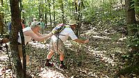 NWA Democrat-Gazette/FLIP PUTTHOFF <br /> Dora Brach (left) and George Riggin keep a safe distance Sept. 16 2015 while photographing a copperhead snake.