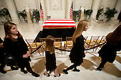 Relatives pass the casket as they leave a private ceremony in the Great Hall of the United States Supreme Court where late Supreme Court Justice Antonin Scalia lies in repose in Washington, DC on Friday, February 19, 2016.<br /> Credit: Jacquelyn Martin / Pool via CNP