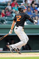 Third baseman Joel Hutter (12) of the Delmarva Shorebirds bats in a game against the Greenville Drive on Friday, April 26, 2013, at Fluor Field at the West End in Greenville, South Carolina. Delmarva won, 10-3. (Tom Priddy/Four Seam Images)