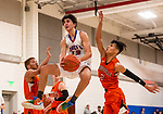 WOODBURY, CT. 03 January 2020-010320BS261 - Nonnewaug's Jon Khazzaka (13) drives to the basket splitting the defense of Terryville's Albert Molina (3) and Dominick Dao (2), during a BL basketball game between Terryville and Nonnewaug at Nonnewaug High School on Friday. Bill Shettle Republican-American