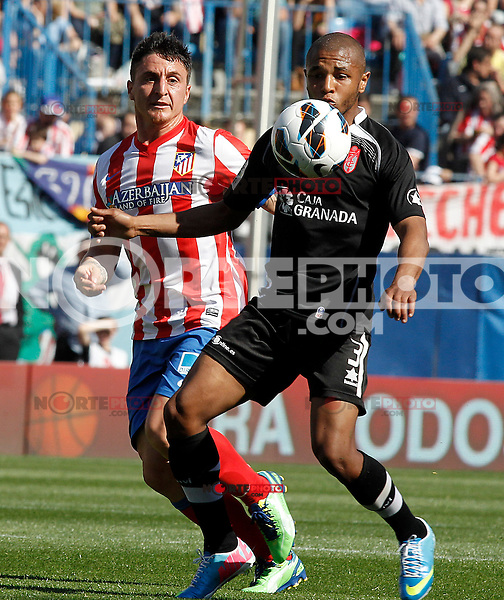 Atletico de Madrid's Cristian Cebolla Rodriguez (l) and Granada's Yacine Brahimi during La Liga match.April 14,2013. (ALTERPHOTOS/Acero)