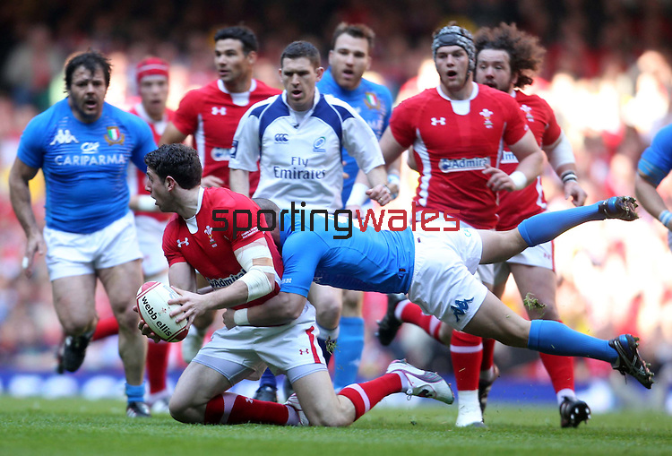 Alex Cuthbert looks for support as Fabio Semenzato flies in..2012 RBS 6 Nations.Wales v Italy.Millennium Stadium..10.03.12.Credit: STEVE POPE-Sportingwales