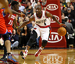 12/26/11--Trail Blazers guard Raymond Felton brings the ball upcourt in the  home-opener with the Philadelphia 76ers at the Rose Garden...Photo by Jaime Valdez. .........................................