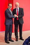 © Joel Goodman - 07973 332324 . 24/09/2016 . Liverpool , UK . The two candidates shake hands on to the stage ahead of the Labour Party leadership declaration in the campaign between Jeremy Corbyn and Owen Smith , at the Liverpool Arena and Convention Centre ahead of the party's 2016 Conference . Photo credit : Joel Goodman