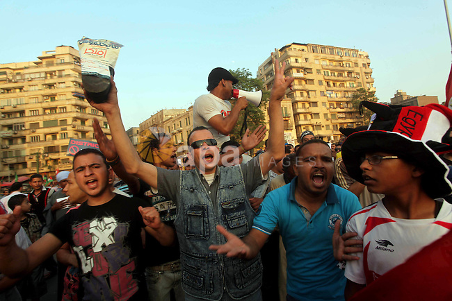 Egyptian protesters chant slogans against Egyptian presidential candidate Ahmed Shafiq in Tahrir Square decrying the result of the first round of voting in the Egyptian presidential election in Cairo, Egypt, Friday, June 1, 2012. Several hundred protesters rallied Friday in Cairo's Tahrir Square, the birthplace of the Egyptian uprising. Photo by Ashraf Amra