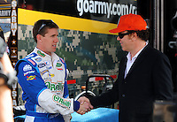 Oct. 10, 2009; Fontana, CA, USA; NASCAR Sprint Cup Series driver Carl Edwards (left) greets actor John C. Reilly during practice for the Pepsi 500 at Auto Club Speedway. Mandatory Credit: Mark J. Rebilas-