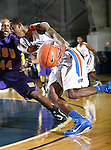 Texas-Arlington Mavericks guard/forward LaMarcus Reed III (31) drives toward the basket in the game between the UTA Mavericks and the Hardin-Simmons Cowboys held at the University of Texas in Arlington's Texas Hall in Arlington, Texas. UTA defeats Hardin-Simmons 88 to 71.