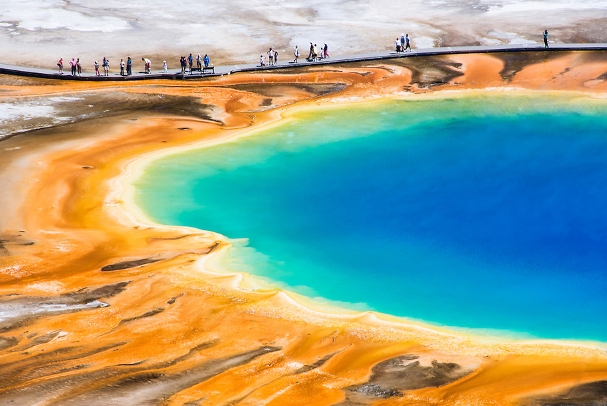 Visitors explore the boardwalk at Grand Prismatic Spring in Yellowstone National Park.