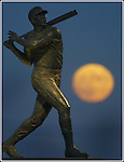 San Francisco Giants Willie McCovery (statue) gets a belt high strike as the hunter October full Moon rising from the east bay hills which signifies closures of any Bay Area teams making to the World Series..
