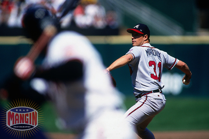 SAN FRANCISCO, CA - Greg Maddux of the Atlanta Braves pitches during a game against the San Francisco Giants at Candlestick Park in San Francisco, California in 1999. Photo by Brad Mangin