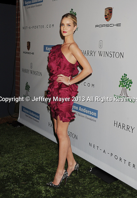 CULVER CITY, CA- NOVEMBER 09: Actress/model Rosie Huntington-Whiteley arrives at the 2nd Annual Baby2Baby Gala at The Book Bindery on November 9, 2013 in Culver City, California.
