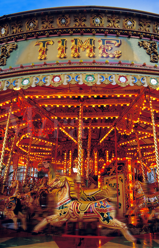 Fairground.  Carousel with horses and other animals.