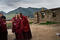 Tibetan Buddhist lama monks gather outside a temple at the Labrang Monastery in Xiahe, Gansu, China. Xiahe, home of the Labrang Monastery, is an important site for Tibetan Buddhists.  The population of the town is divided between ethnic Tibetans, Muslims, and Han Chinese.