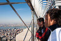 Former men's national team players Tab Ramos and Cobi Jones (Right) look out from the observation deck of the Empire State Building during the centennial celebration of U. S. Soccer in New York, NY, on April 05, 2013.