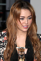 """LOS ANGELES - FEB 8:  Miley Cyrus arrives at the """"Never Say Never"""" Premiere at Nokia Theater  on February 8, 2011 in Los Angeles, CA"""