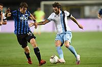 24th June 2020, Bergamo, Italy; Seria A football league, Atalanta versus Lazio;  Luis Alberto challenged by Marten de Roon