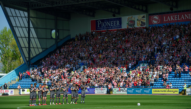 Lincoln City players and fans during a minutes applause, in memory of Ivor Broadis<br /> <br /> Photographer Chris Vaughan/CameraSport<br /> <br /> The EFL Sky Bet League Two - Carlisle United v Lincoln City - Friday 19th April 2019 - Brunton Park - Carlisle<br /> <br /> World Copyright © 2019 CameraSport. All rights reserved. 43 Linden Ave. Countesthorpe. Leicester. England. LE8 5PG - Tel: +44 (0) 116 277 4147 - admin@camerasport.com - www.camerasport.com