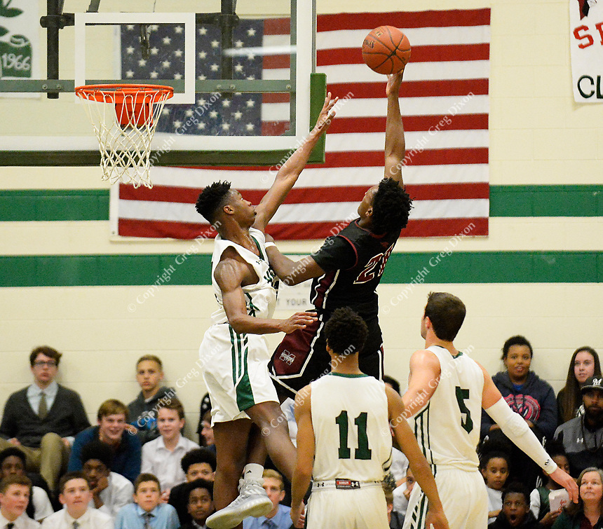 Middleton's Myron Ashford Jr. takes a shot over Memorial's Chris Knight during the first half of the Big Eight Conference boys basketball game between Middleton and Madison Memorial on Thursday at Memorial High School in Madison