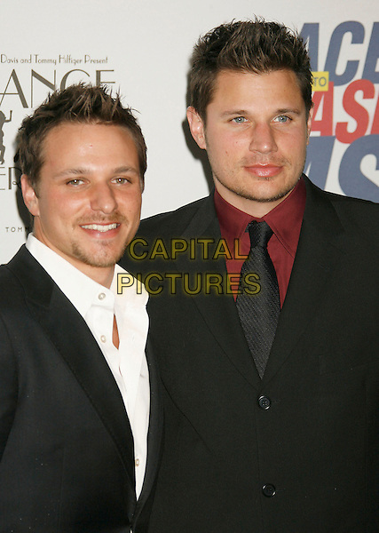 """DREW LACHEY & NICK LACHEY.14th Annual Race to Erase MS Themed """"Dance to Erase MS"""" held at the Century Plaza Hotel, Century City, California, USA, 13 April 2007..half length brothers siblings family black suit tie red shirt.CAP/ADM/RE.©Russ Elliot/AdMedia/Capital Pictures."""