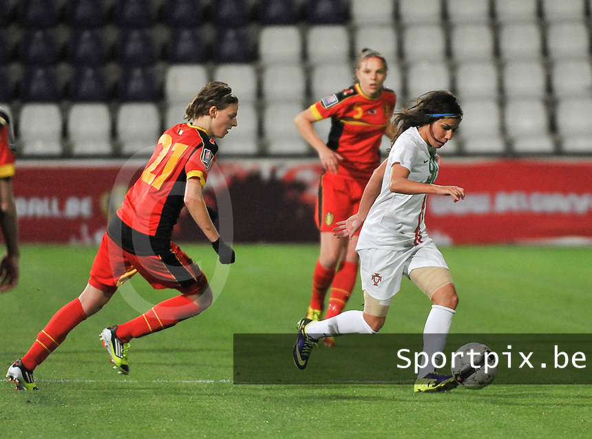 20131031 - ANTWERPEN , BELGIUM : Belgian Yana Daniels (21) pictured with Portugese Ana Borges (right) during the female soccer match between Belgium and Portugal , on the fourth matchday in group 5 of the UEFA qualifying round to the FIFA Women World Cup in Canada 2015 at Het Kiel stadium , Antwerp . Thursday 31st October 2013. PHOTO DAVID CATRY